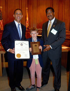 Councilman Stewart Cumbo and Lt Governor Anthony Brown presenting an Award